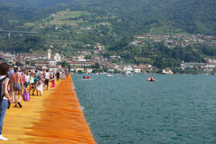 The Floating Piers in Lake Iseo. LAKE ISEO, ITALY - CIRCA JULY 2016: The Floating Piers landscape artwork by Christo and Jeanne Claude Stock Image