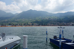 The Floating Piers in Lake Iseo. LAKE ISEO, ITALY - CIRCA JULY 2016: The Floating Piers landscape artwork by Christo and Jeanne Claude Stock Images