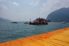 The Floating Piers in Lake Iseo. LAKE ISEO, ITALY - CIRCA JULY 2016: The Floating Piers landscape artwork by Christo and Jeanne Claude Stock Photos