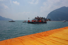 The Floating Piers in Lake Iseo. LAKE ISEO, ITALY - CIRCA JULY 2016: The Floating Piers landscape artwork by Christo and Jeanne Claude Royalty Free Stock Photo