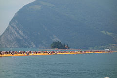 The Floating Piers in Lake Iseo. LAKE ISEO, ITALY - CIRCA JULY 2016: The Floating Piers landscape artwork by Christo and Jeanne Claude Stock Photo