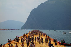 The Floating Piers in Lake Iseo. LAKE ISEO, ITALY - CIRCA JULY 2016: The Floating Piers landscape artwork by Christo and Jeanne Claude Royalty Free Stock Images
