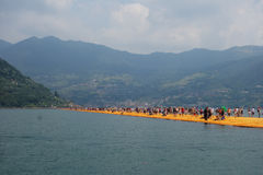The Floating Piers in Lake Iseo. LAKE ISEO, ITALY - CIRCA JULY 2016: The Floating Piers landscape artwork by Christo and Jeanne Claude Stock Photography