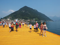 The Floating Piers in Lake Iseo. LAKE ISEO, ITALY - CIRCA JUNE 2016: The Floating Piers site specific landscape artwork by Christo and Jeanne Claude Royalty Free Stock Photos