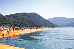 The Floating piers: the people. The Folating piers, people walking and panorama Royalty Free Stock Photos