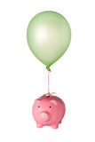 Floating piggy bank Stock Photography