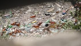 Floating Plastic bottles and different garbage in a polluted water. Floating Plastic bottles and different garbage in a polluted river water. Rubbish in a stock footage