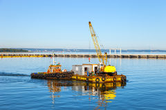 Floating pontoon and crane Stock Images