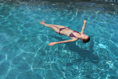 Floating in the pool Stock Images