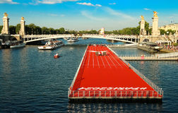 The floating race track installed on Seine river near Alexandre III bridge in Paris, France . Royalty Free Stock Photography