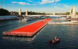 The floating race track installed on Seine river near Alexandre III bridge in Paris, France . Stock Images