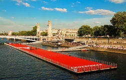 The floating race track installed on Seine river near Alexandre III bridge in Paris, France . Stock Photos