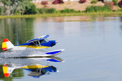 A floating Radio controlled model seaplane Stock Images