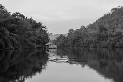 Floating raft house on lake in black and white Stock Photos