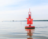 Floating red beacon in the ocean Royalty Free Stock Images
