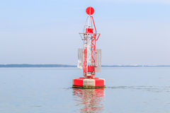 Floating red beacon in the ocean Royalty Free Stock Photography