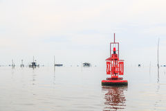 Floating red beacon in the ocean Stock Image