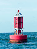 Floating red buoy at mid of sea Stock Images