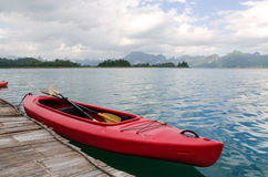 Floating red Canoe in Ratchaprapha Dam at Khao Sok National Park Royalty Free Stock Photos