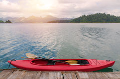 Floating red Canoe in Ratchaprapha Dam at Khao Sok National Park Royalty Free Stock Photo