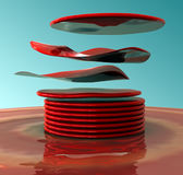 Floating red discs. An abstract art piece with floating red discs on a blue background Stock Photos