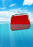 Floating red wallet at ocean, colorful finance concept Stock Photos