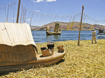 Floating reed island and boats Royalty Free Stock Photo