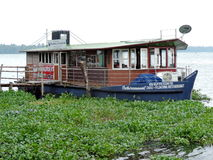 Floating restaurant in the backwaters of Kerala, India. Surrounded by green plantation Royalty Free Stock Photos