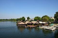 Floating restaurant beside River Kwai at Kanchanaburi, Thailand Stock Photos