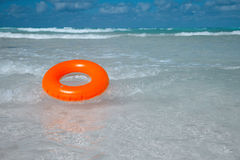 Floating  ring on blue clear sea Royalty Free Stock Photo