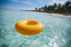Floating ring on blue clear sea with beach Stock Photo