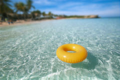 Floating ring on blue clear sea with beach Royalty Free Stock Photography