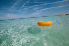 Floating ring on blue clear sea with seascape Royalty Free Stock Photo