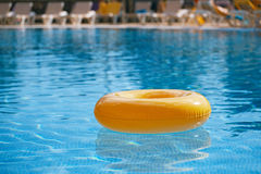Floating ring on blue water swimpool Royalty Free Stock Photos