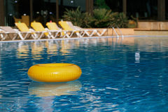 Floating ring on blue water swimpool Stock Image