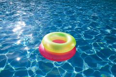 Floating rings on blue water swimpool Stock Photography