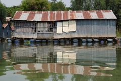 Floating river house. Metal house floating on the Mekong river Stock Image