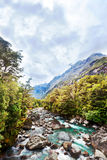 Floating river in the mountain valley. Floating blue river in the mountain valley stock images
