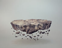 Floating Rock Island. A levitating rock, with crumbling bits perfect as a base for product displays or lost worlds Royalty Free Stock Photography