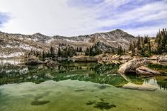 Floating Rocks. High mountain lake with huge boulders sticking out of the crystal clear water Stock Image