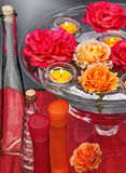 Floating roses and candles 3. Dish of glass and water with swimming roses and candles for aromatherapy, reiki, ayurveda Royalty Free Stock Images