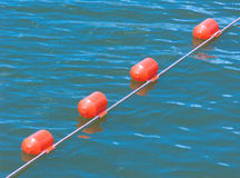 Floating safety buoy. Orange safety buoy Stock Photos