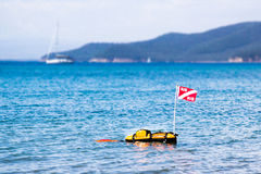 Floating scuba presence buoy. Scuba floating buoy in Italian coast, with yacht in the background Stock Images