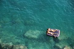 Floating in the Sea stock image