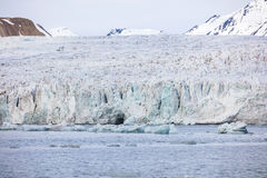 Floating sea ice in front of massive glacier in arctic Royalty Free Stock Photo