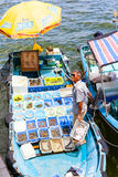 Floating Seafood Market in Sai Kung, Hong Kong. HONG KONG - JULY 13, 2017: A fisherman separates his live seafood catch into plastic containers on a boat at Sai royalty free stock images