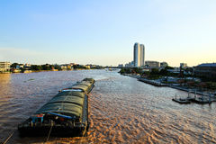 Floating ships on the Chao Phraya River Royalty Free Stock Photo