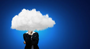 Floating in sky. Businesswoman standing with his head in cloud Stock Photo