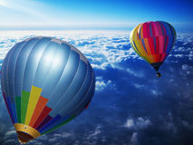 Floating through the sky. A photo render of two hot air ballons flying above the sky on a peacful journey Royalty Free Stock Image