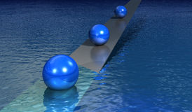 Floating spheres in water Royalty Free Stock Photography
